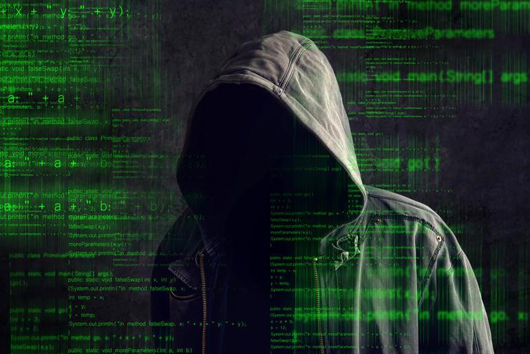 Faceless hooded anonymous computerhacker